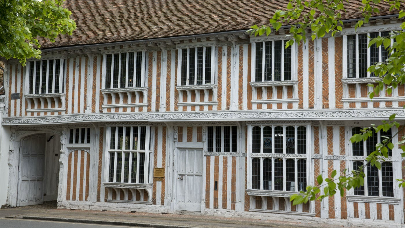 A Tudor timber framed building with cartway on the left