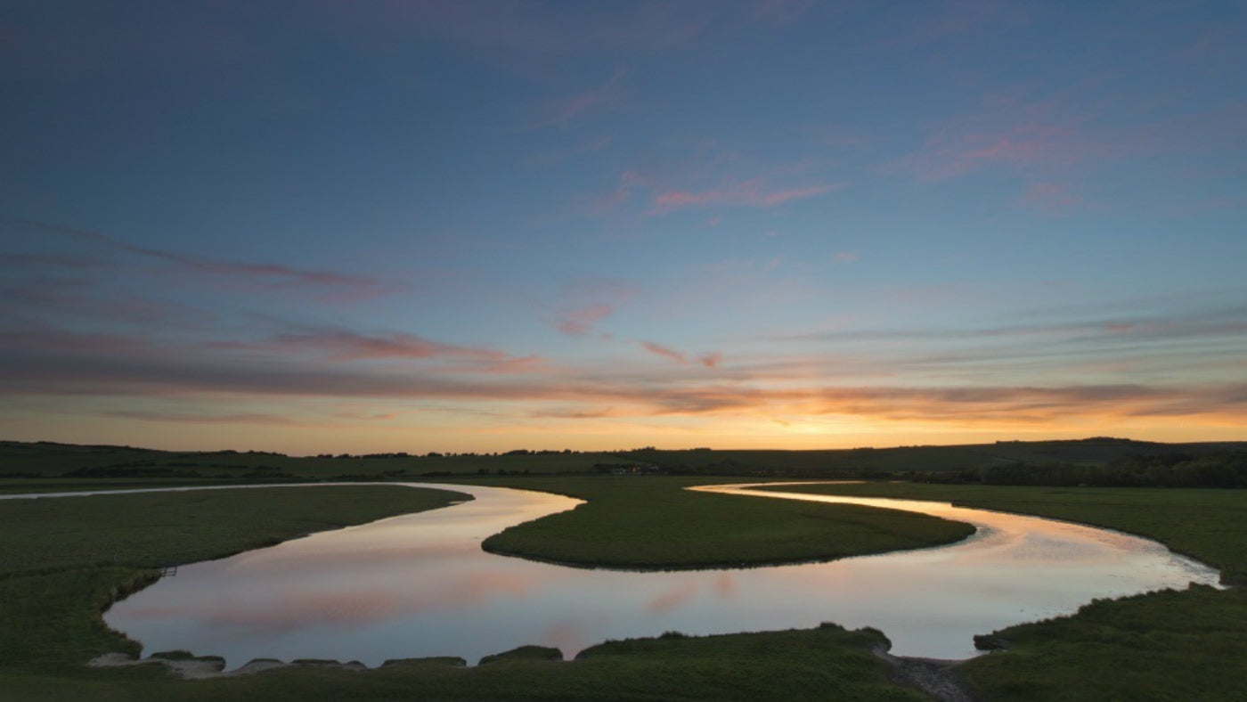 Sunset lends stunning colours to the winding Cuckmere meanders