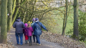 Family on a winter walk through woodland