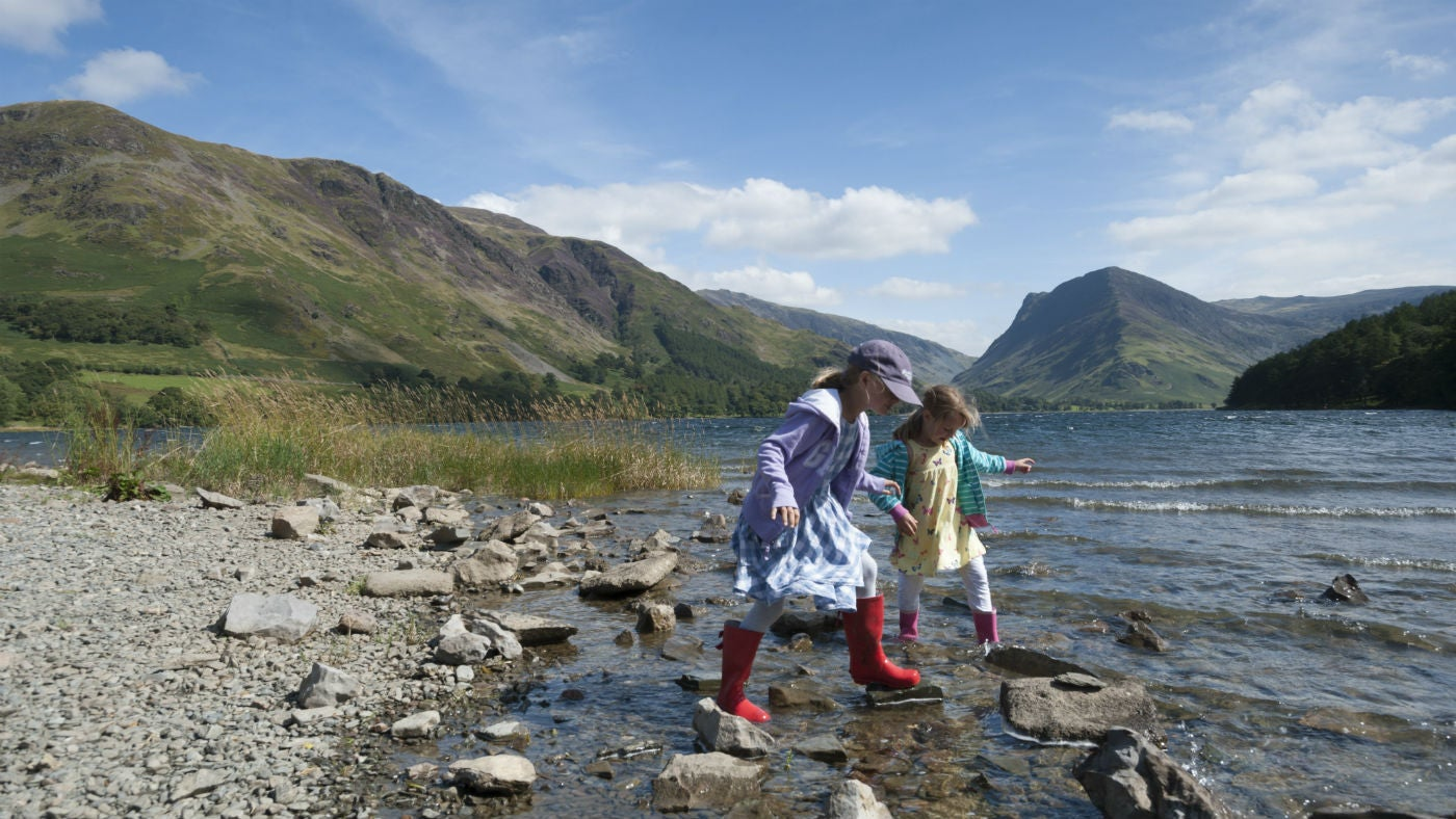 Children enjoying Buttermere Lake, Cumbria