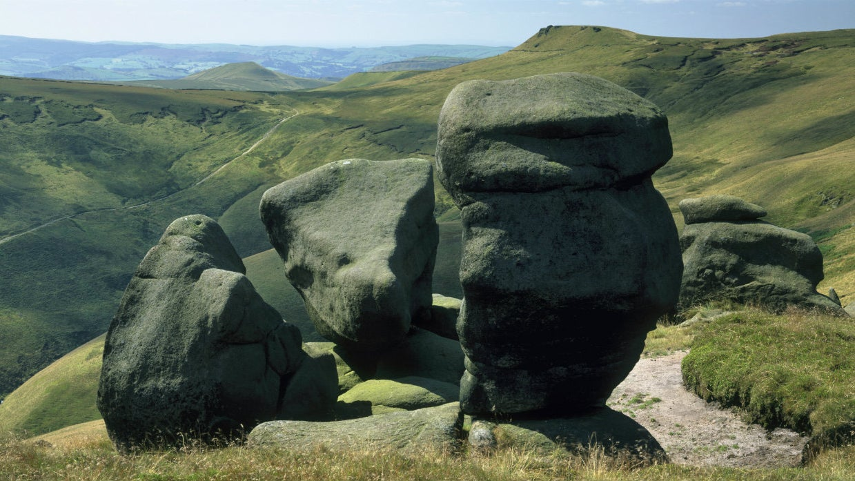Standing rocks above deep valley, Peak District