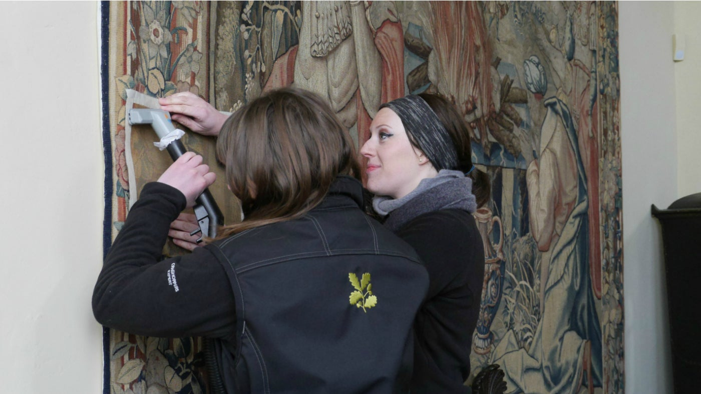 Staff conserving a tapestry at Packwood House
