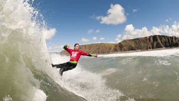 Surfing at Poldhu, Helston