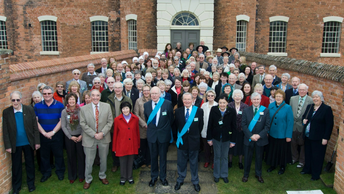 Group photo of The Workhouse's volunteer community infront of the building