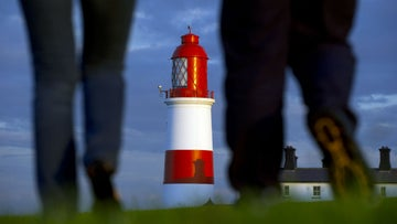 Visitors walking towards Souter Lighthouse and The Leas