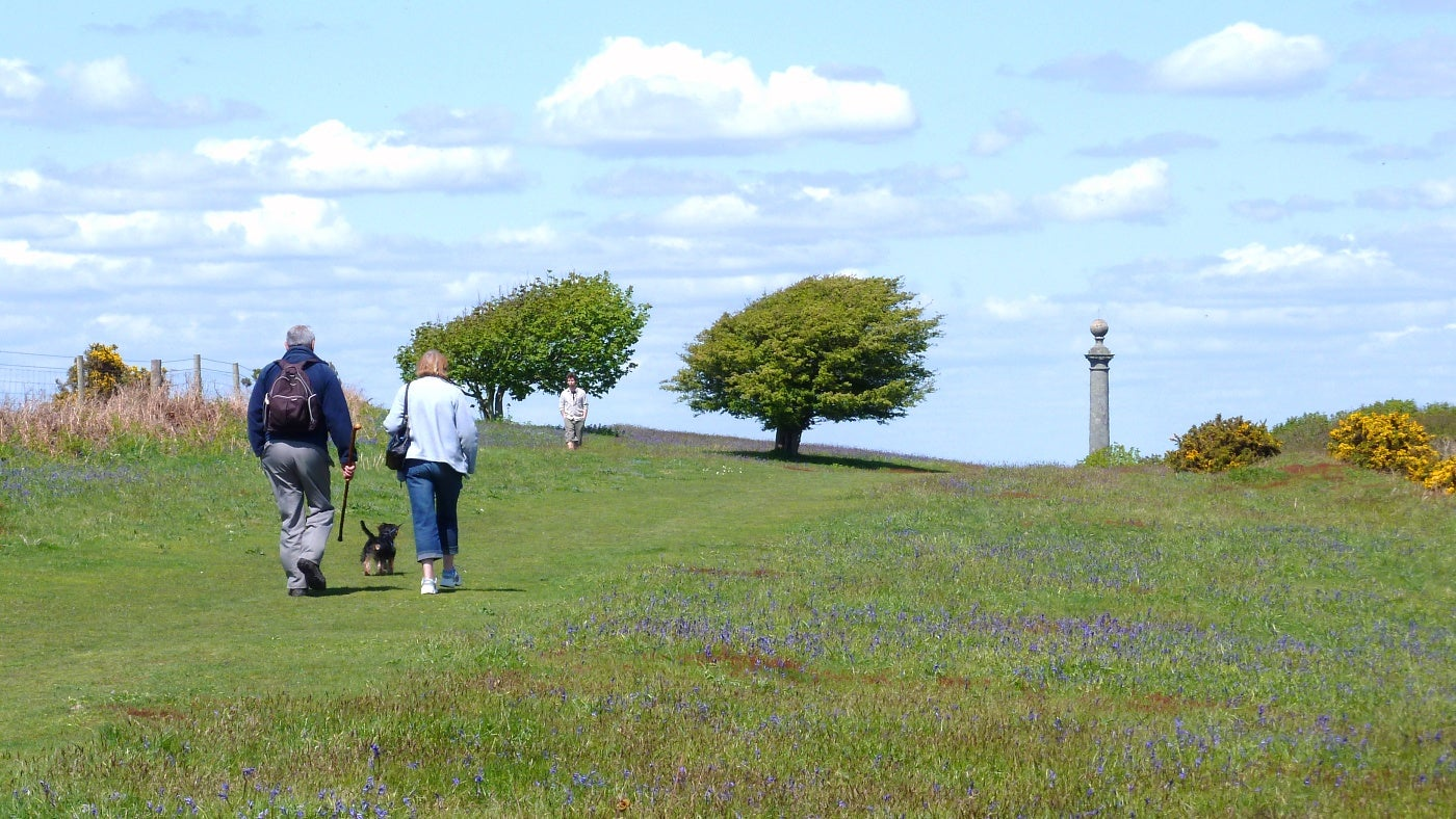 A couple walking along St Catherine's Down, Isle of Wight
