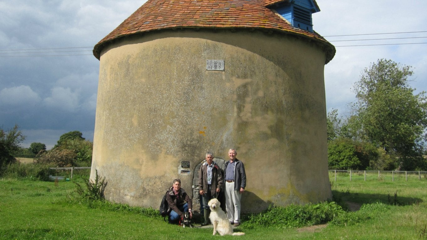 Kinwarton Dovecote with walkers and dog
