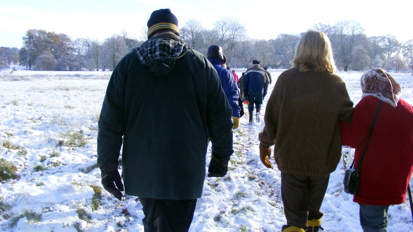 Visitors strolling in the snow at Belton