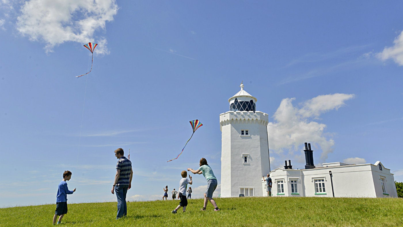Family flying kites at South Foreland Lighthouse