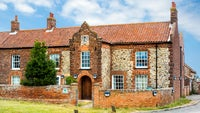 Brick and flint built cottage that comprises of Brancaster Activity Centre