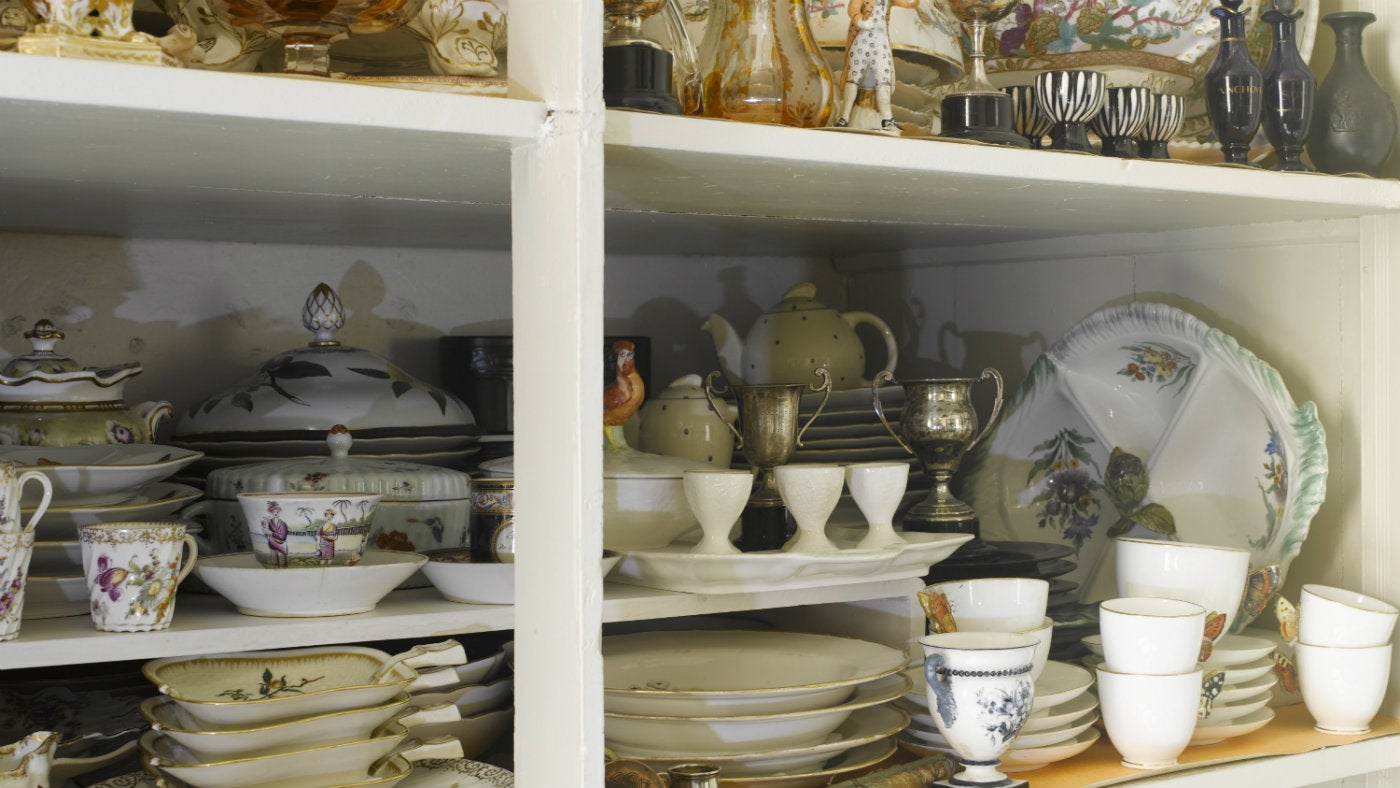 The cupboards in the Winter Dining Room at Greenway are filled with collections