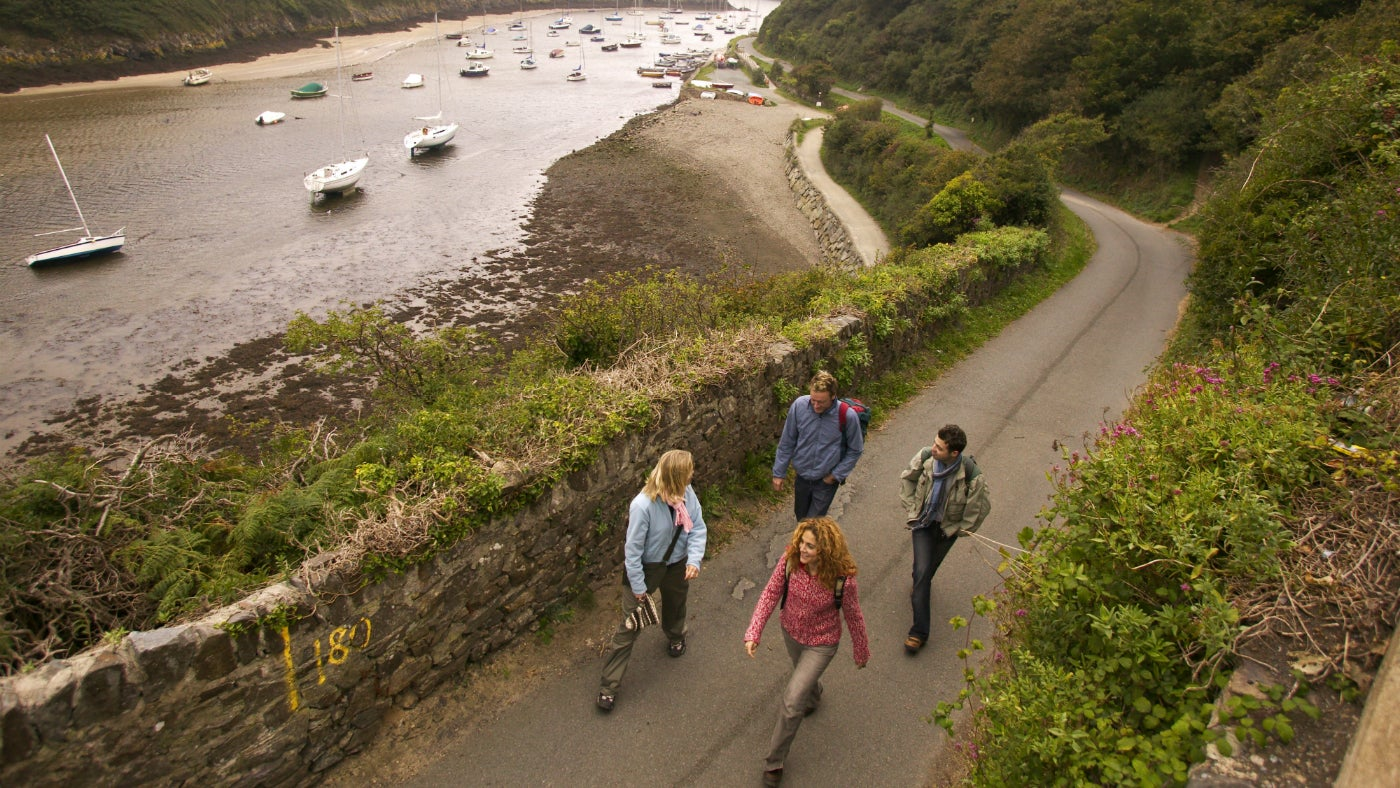 Two couples walking the coast path at Solva Harbour