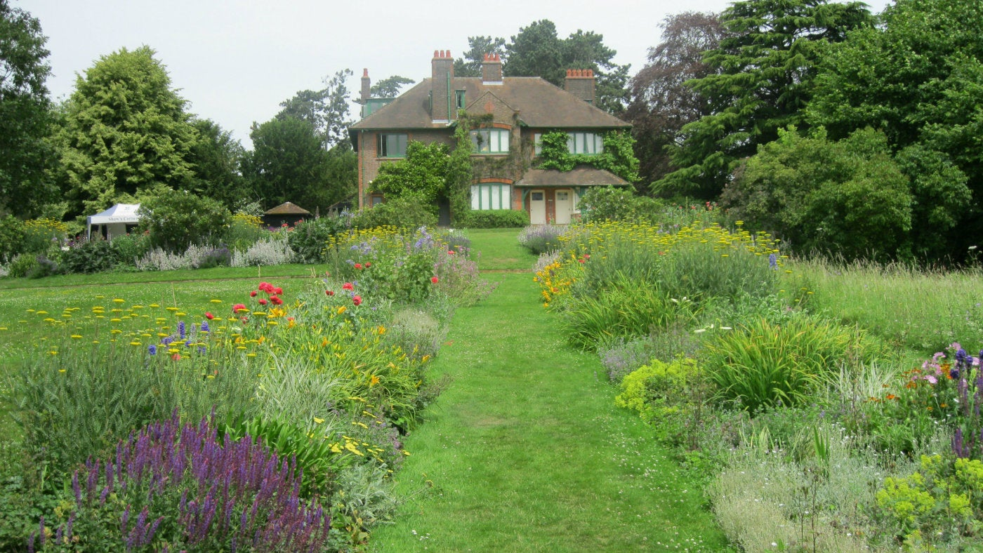 A view of Shaw's Corner from the bottom of the garden looking up from the flower beds to the house