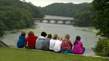 Children enjoying the view from Stackpole Courtsite
