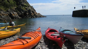 A row of kayaks at Stackpole Quay
