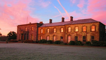 The house at Arlington Court lit by early morning winter light