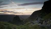 Sunset behind rocks at Alport Castles, Dark Peak, Derbyshire