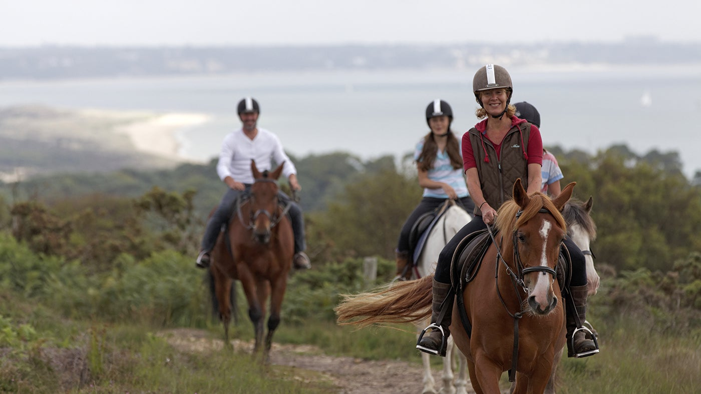 Horse riding at Studland, Dorset