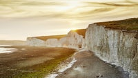 Yellow and golden sunset views over the Seven Sisters cliffs