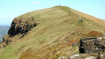 Walkers reaching the summit of the Skirrid, Monmouthshire