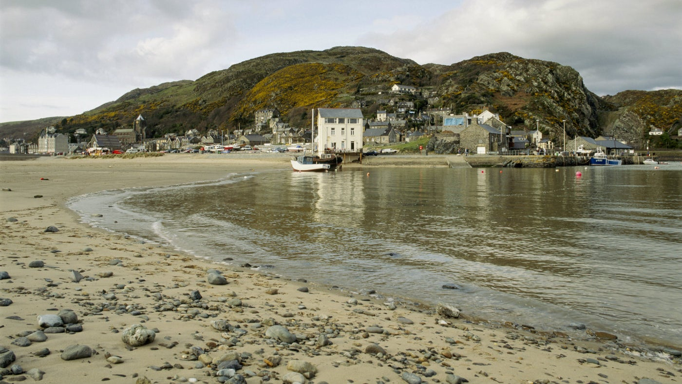 Dinas Oleu headland with Barmouth town and coastline in the foreground