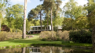 View across the lake to The Homewood in Surrey