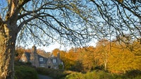 The cottage at Stoneywell in autumn light