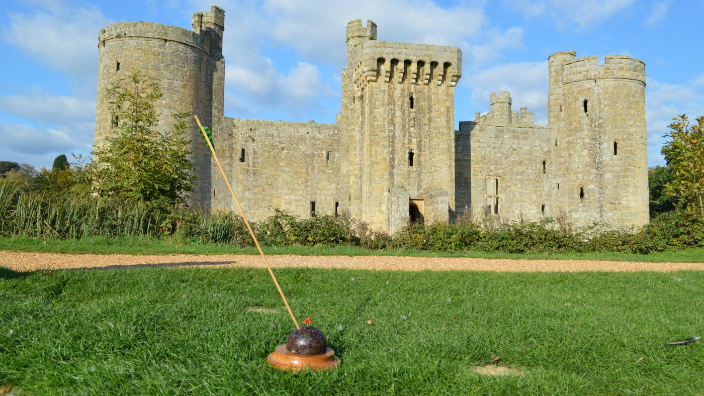 An arrow shot through a Christmas pudding in front of Bodiam Castle
