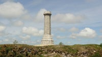 Hardy Monument standing tall against a blue sky