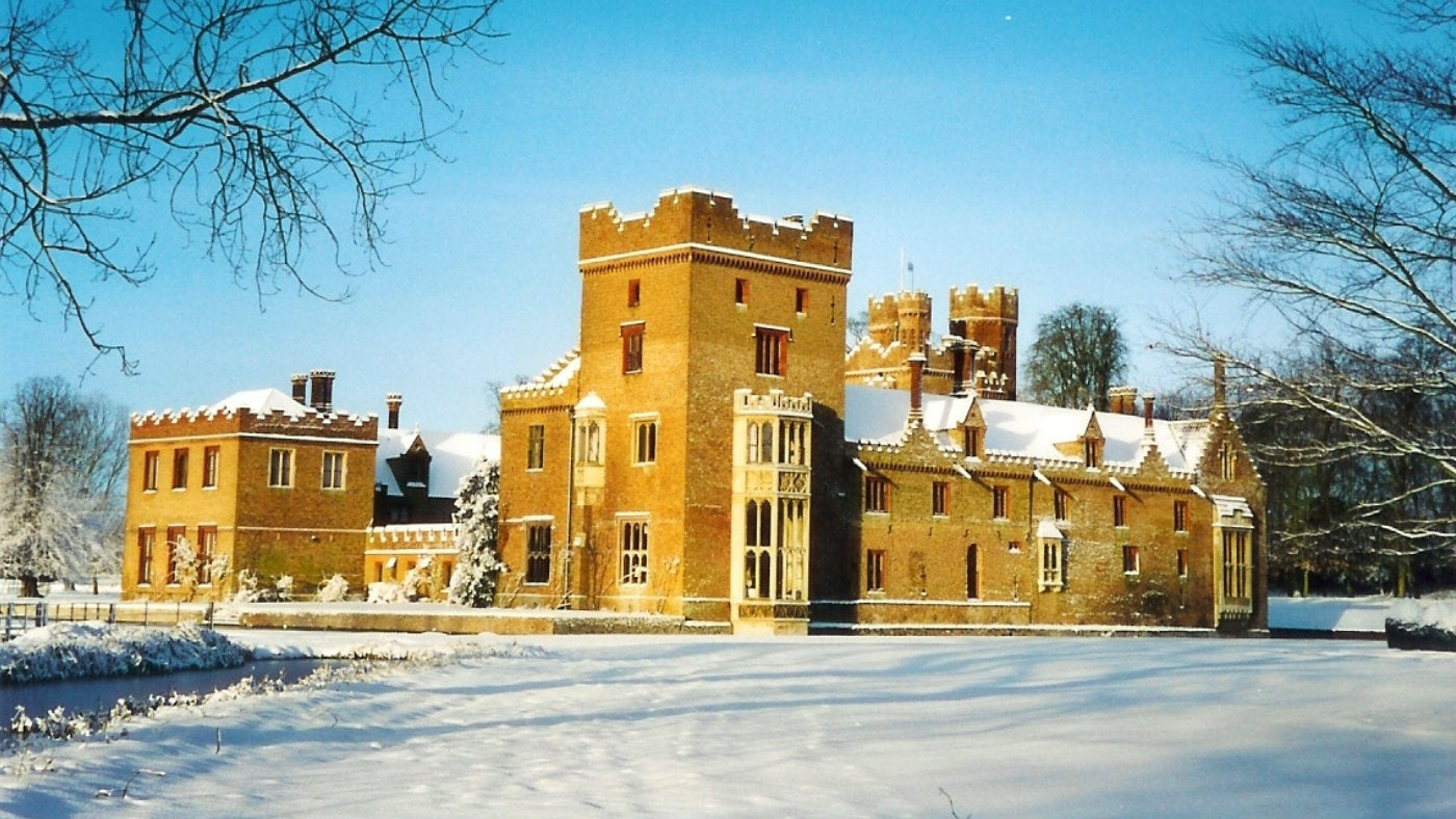 A view of Oxburgh Hall after a snowfall.