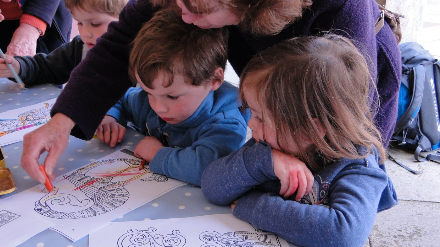 Volunteers help with family activities at Knole, Kent.