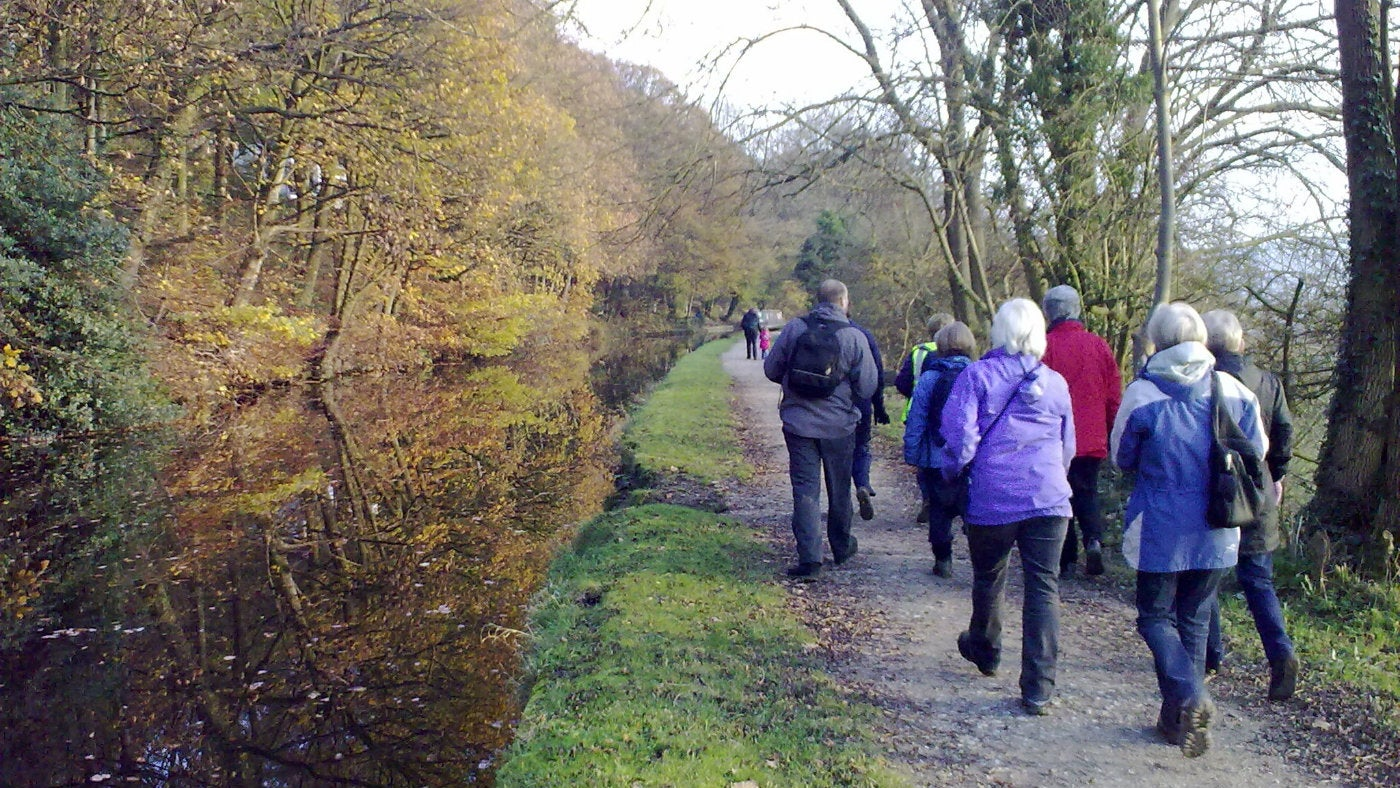 Group of walkers taking a stroll along the canal footpath