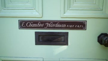 The front door showing name plaque at the Hardmans' House, Liverpool