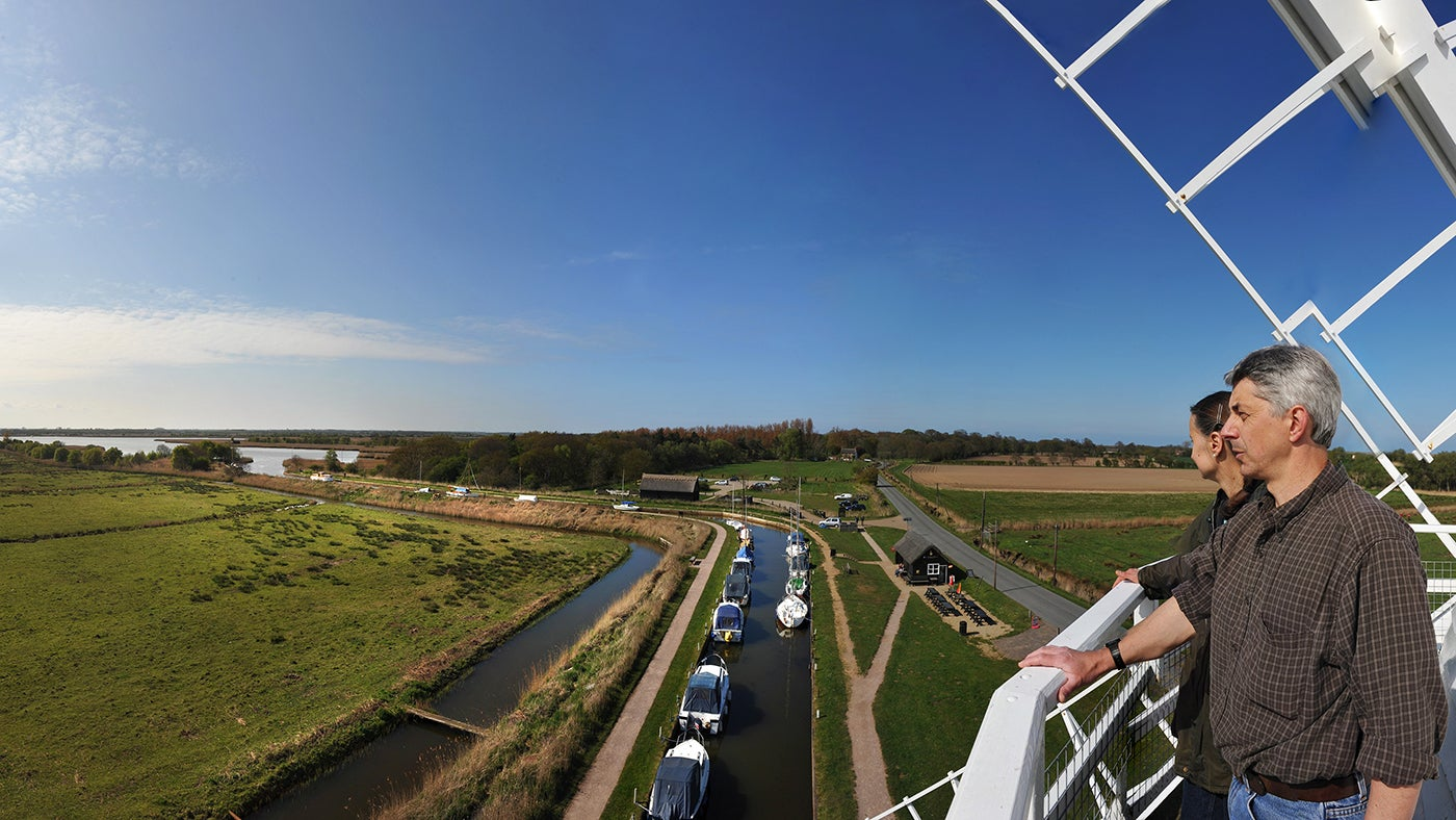 A couple looking out across the view from the top of Horsey Windpump