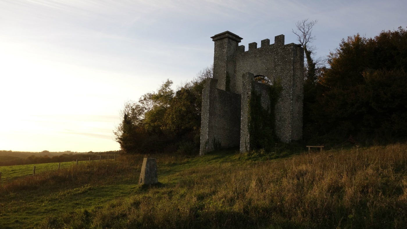 Views across Slindon folly at sunset on the South Downs
