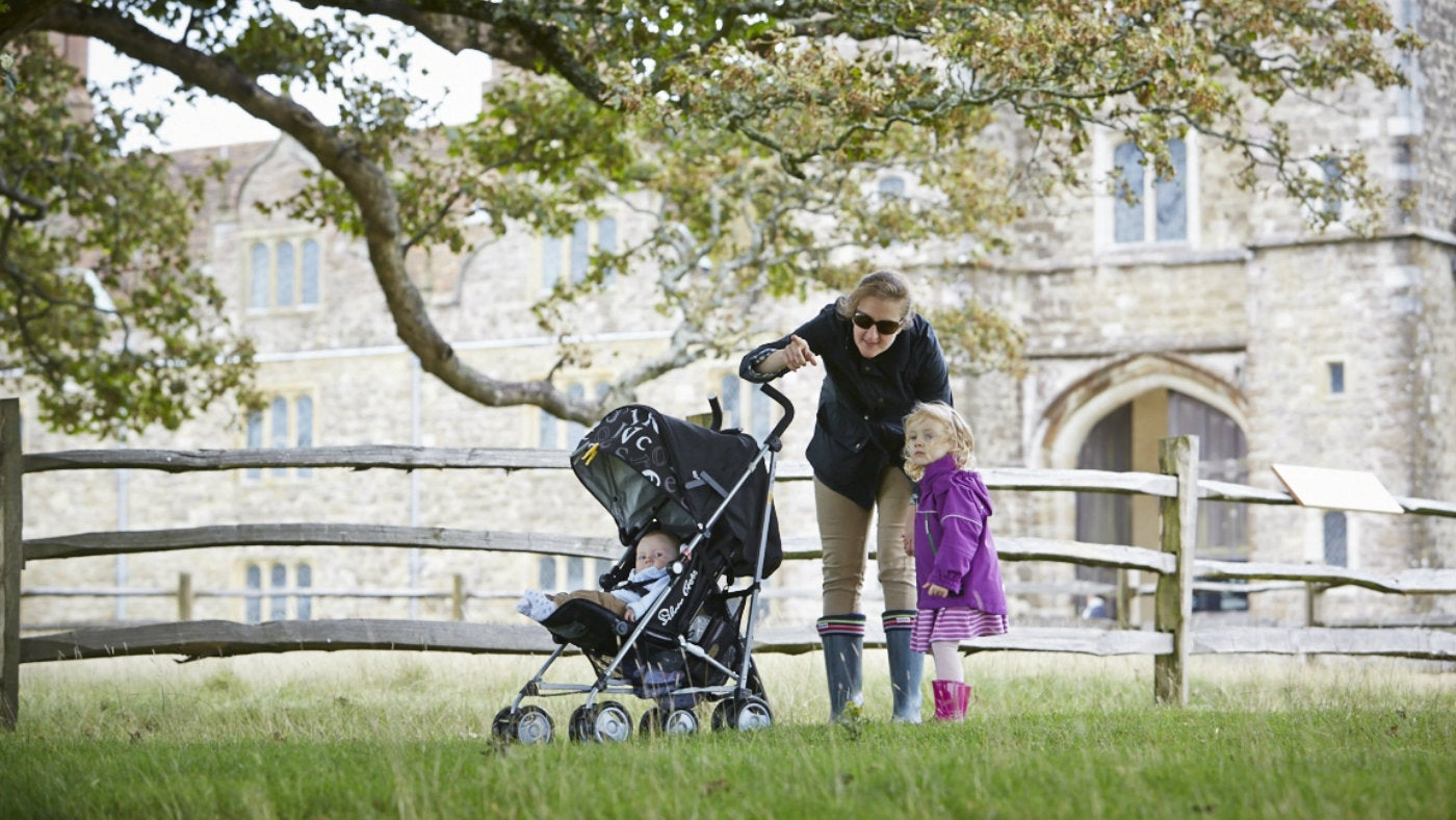 A family enjoys the sights in Knole Park, Kent