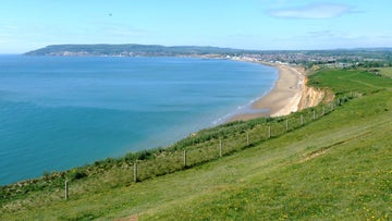 Blue sea and a ribbon of sand around Sandown Bay as seen from the cliffs of Culver