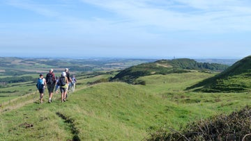 Walkers preparing to walk along the ridge of St Catherine's Down