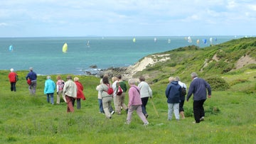 Lots of walkers and lots of yachts passing the southern tip of the Isle of Wight