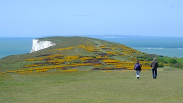 Two walkers setting out along the Needles headland