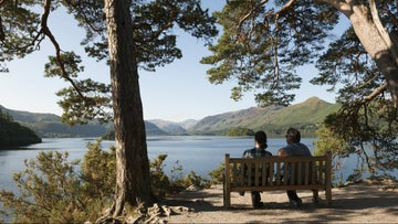 Visitors enjoy the view from Friar's Crag, Borrowdale