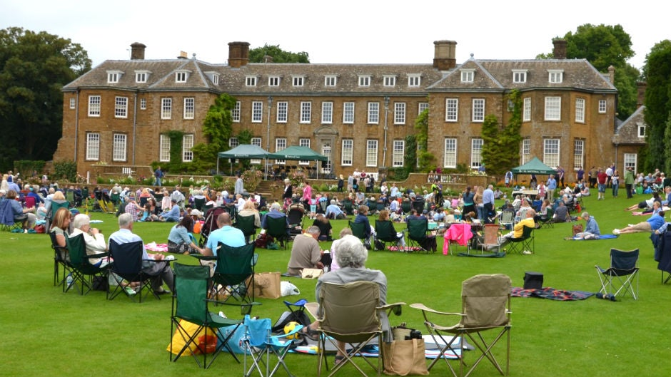 People picnicing on the lawn at Upton watching a concert
