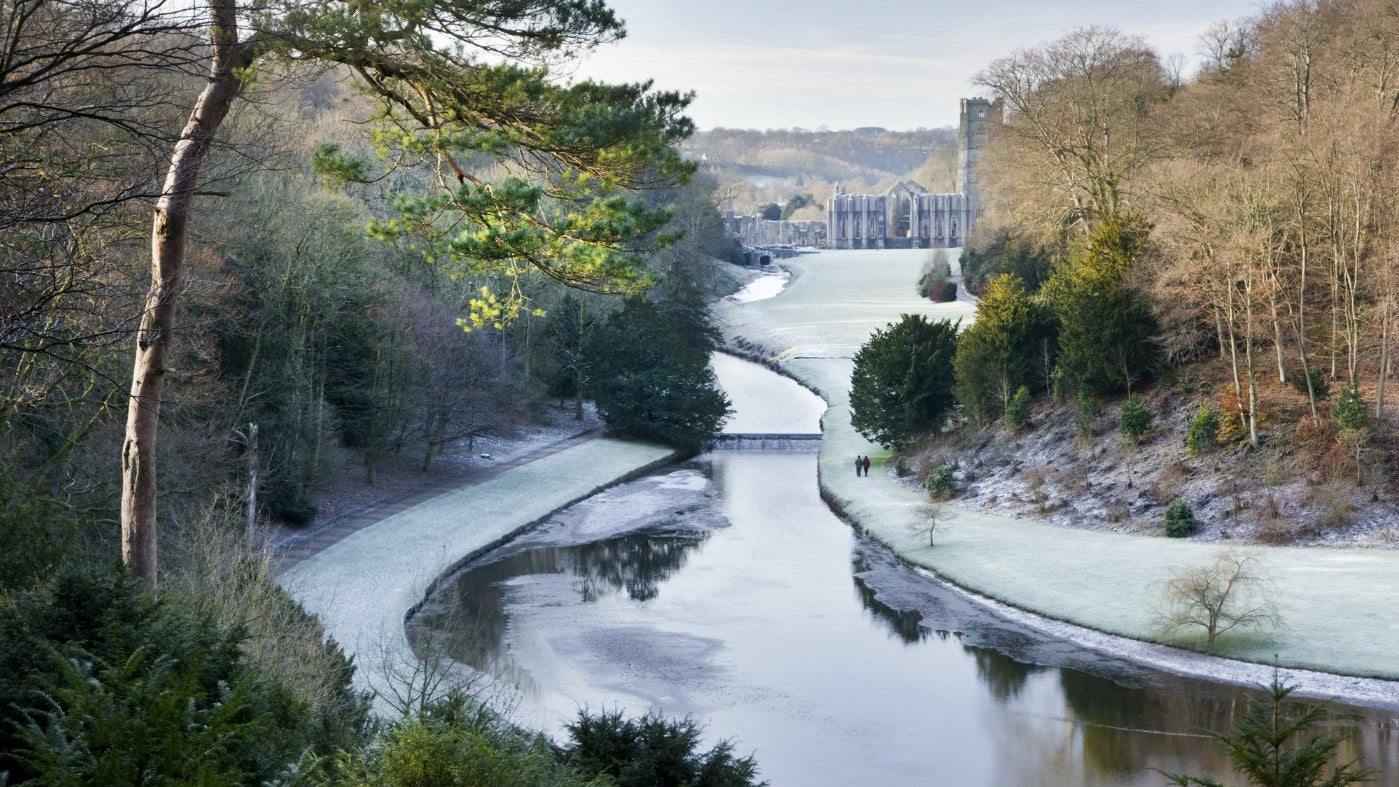 Frost covered view to Abbey from Studley Royal water garden