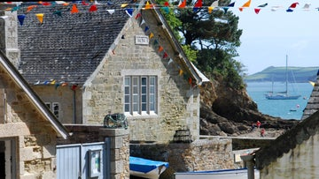 Bunting decorates the village of Durgan in Cornwall for the annual regatta in summer