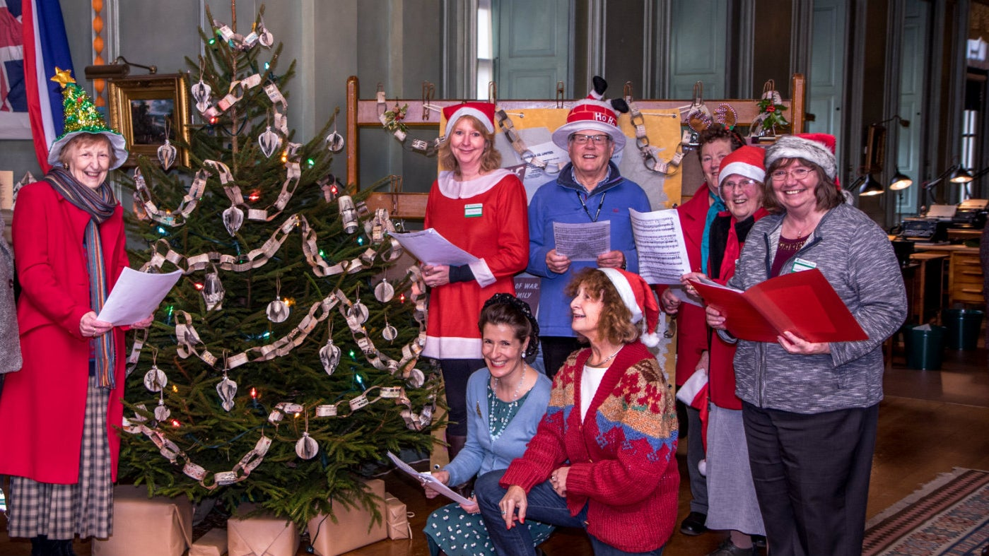 Groups of singers round the Christmas Tree