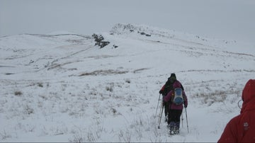 People walking in snow along Hadrian's Wall