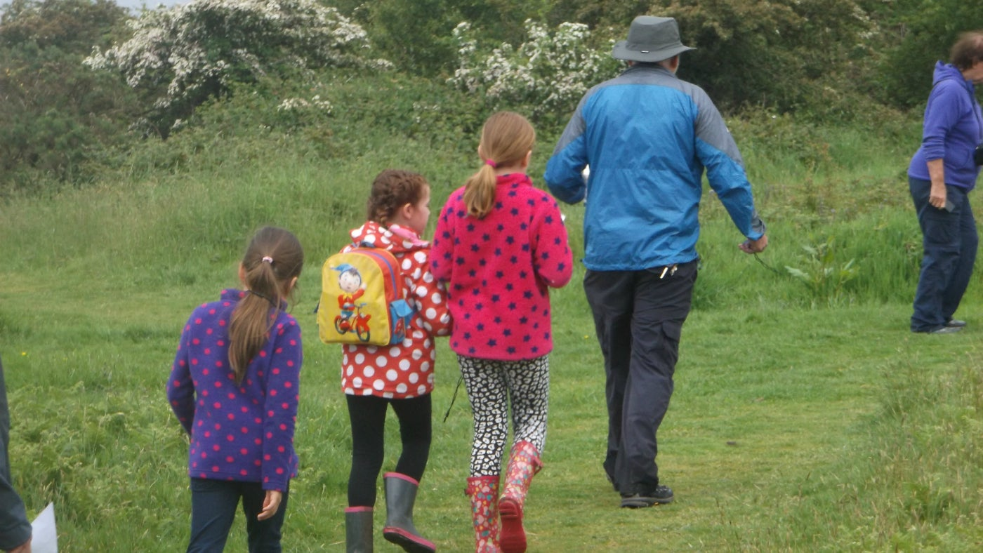 Children following a trail along a footpath at Stonebarrow on the Golden Cap Estate