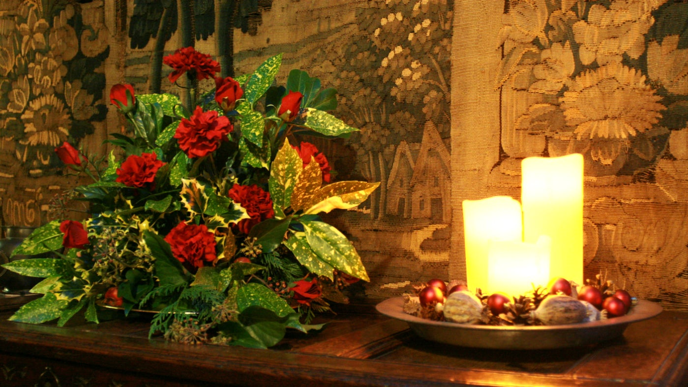 The upper hall decorated for Christmas at Wightwick Manor