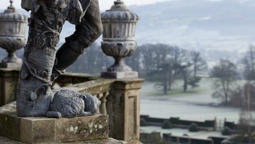 A lead statue in winter at Powis Castle and Garden, Powys, Wales