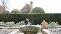 Alfriston Clergy House East Sussex frosty sundial in vegetable garden